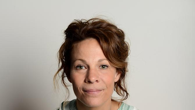 """This Monday July 15, 2013 photo shows actress Lili Taylor posing for a portrait in Los Angeles. Taylor stars in the haunted-house thriller """"The Conjuring,"""" opening nationwide on Friday, July 19. (Photo by Jordan Strauss/Invision/AP)"""