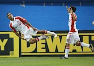 Quincy Amarikwa (L) of Toronto FC celebrates his goal with Sergio Camargo against Liverpool during the World Football Challenge friendly match at Rogers Centre in Toronto. The match ended in a 1-1 draw