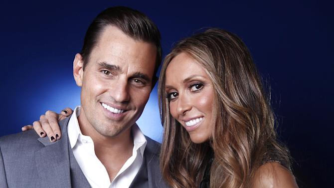 FILE - In this April 2, 2012 file photo, Bill and Giuliana Rancic pose for a portrait in New York. The Rancics are expecting their first child via a gestational surrogate. (AP Photo/Carlo Allegri, File)