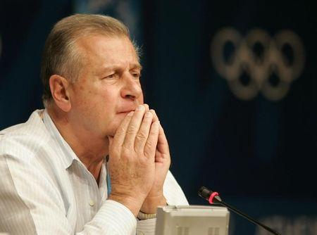 Former disciplinary spokesman for the International Olympic Committee Francois Carrard pauses during a news conference