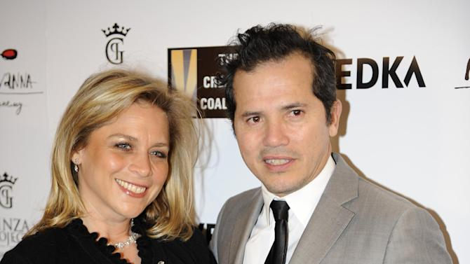 John Leguizamo, right, arrives at the Creative Coalition Night Before Dinner on Sunday, Jan. 20, 2013, in Washington. (Photo by Nick Wass/Invision/AP)