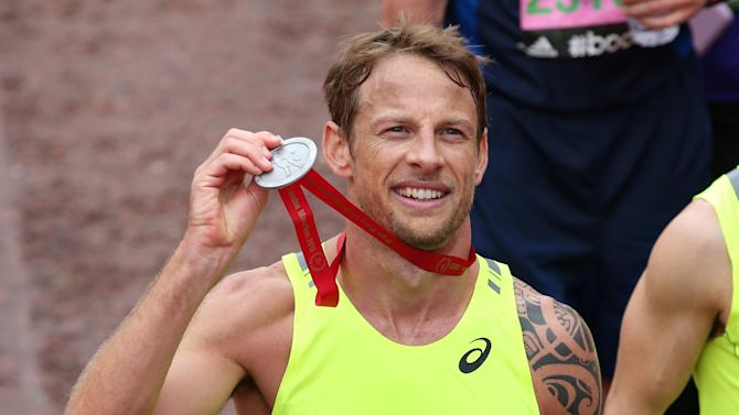Athletics: Formula One driver Jenson Button poses with his medal after finishing the Virgin Money London Marathon