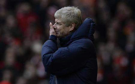 Arsenal's manager Wenger reacts during their English Premier League soccer match against Liverpool at Anfield Stadium in Liverpool