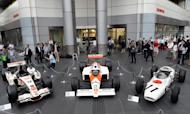 Three generations of Honda Formula One cars -- the 2006 Honda RA106 (left), the 1988 McLaren Honda MP4/4 (centre) and 1965 Honda RA272 -- on display in Tokyo, on May 16, 2013. Honda has said it will return to Formula One in 2015 as an engine supplier to British team McLaren in a bid to revive their championship-winning partnership