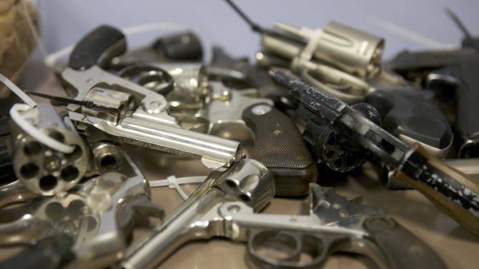 Assorted hand guns turned in during a gun buyback event at the Bridgeport Police Department's Community Services Division in Bridgeport