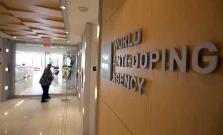 A woman walks into the head offices for WADA in Montreal