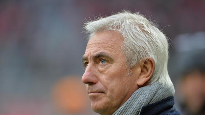 "In this Dec. 14, 2013 file photo Hamburg head coach Bert van Marwijk waits for the kickoff of the German first division Bundesliga soccer match between FC Bayern Munich and Hamburger SV in Munich, Germany. Hamburger SV sacked Dutch coach van Marwijk on Saturday, Feb. 15, 2014, after the side's seventh consecutive Bundesliga loss, its eighth overall. ""We were forced to make this decision at this time, although we regret it,"" Hamburg sporting director Oliver Kreuzer said. ""We thank Bert van Marwijk for his work."""
