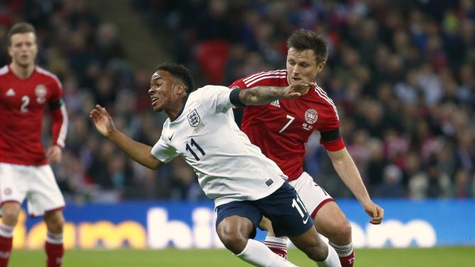 England's Sterling is fouled by Denmark's Kvist during their international friendly soccer match at Wembley stadium in London
