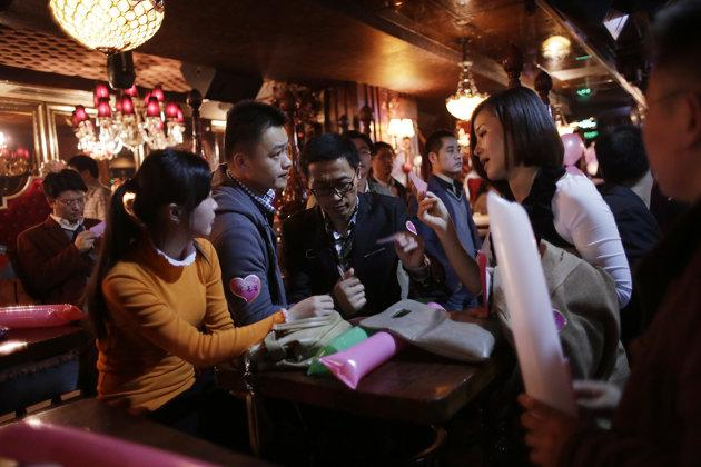 Dating vouchers have been introduced to encourage singles to widen their social circle. (AP file photo)