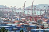 Containers are seen stacked up at a terminal in the southeastern port city of Busan. S.Korea on Sunday reported its biggest trade surplus in 21 months as rising exports to the Middle East and Southeast Asia offset falling demand from the United States and Europe
