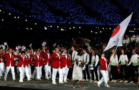 Japan's flag bearer Yoshida holds the national flag as she leads the contingent in the athletes parade during the opening ceremony of the London 2012 Olympic Games at the Olympic Stadium