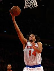 Chris Copeland of the New York Knicks heads for the net as Marcus Morris of the Houston Rockets defends on December 17, 2012 at Madison Square Garden in New York City. The Rockets defeated the Knicks 109-96. Copeland, who was starting in place of injured Carmelo Anthony, scored all of his career-best 29 points in the second half