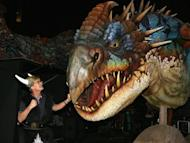 "Actor Kyle McLaughlin with the extremely dangerous Nadder backstage at DreamWorks' ""How To Train Your Dragon Live Spectacular"" at Nassau Coliseum, Long Island on August 4. The studio's newly-formed China joint venture, Oriental DreamWorks, is set to open the tourism attraction in 2016, the creator of megahits like ""Shrek"" and ""Kung Fu Panda"" said in a statement"