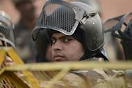 Indian riot police look on as they keep watch along a sealed-off road leading towards the landmark India Gate monument following weekend clashes between demonstrators and police in New Delhi on December 24, 2012. Indian Prime Minister Manmohan Singh has appealed for calm and vowed to protect women as police struggled to quell increasing outrage over sex crimes following the gang-rape of a student