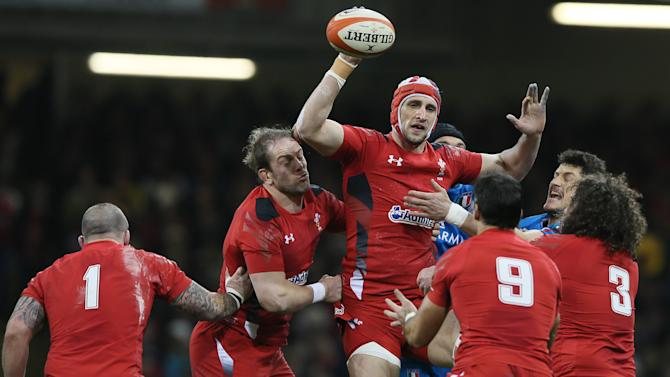 Wales's Luke Charteris gets the ball ready to pass on from a line out during the Six Nations international rugby union match between Wales and Italy at the Millennium stadium in Cardiff, Wales, Saturday Feb. 1, 2014 (AP Photo/Alastair Grant)