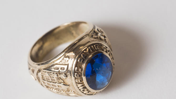 This June 10, 2014, handout photo proved by Howard Payne University shows A 1953 Howard Payne University class ring in Brownwood, Texas. An 84-year-old Washington state woman will soon be reunited with her 1953 university class ring after someone found it in a dried-up West Texas lake in March. Elizabeth Clark lost her Howard Payne University class ring in 1954 in Lake Nasworthy near San Angelo when she and her future husband went for a picnic and to wade into the water. (AP Photo/Howard Payne University/Matthew Lester)