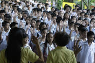 Filipino students recite the oath of allegiance during the first day of class at the GSIS Elementary School in suburban Quezon City, north of Manila, Philippines on Monday June 6, 2011. Nearly 26 millions students trooped back to school Monday amid perennial problems like overcrowded classrooms, lack of teachers and desks.