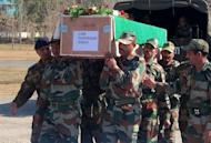Indian army personnel carry the coffin of soldier Lance Naik Sudhakar Singh at Rajouri, some 148 kms from Jammu, on January 9, 2013. India delivered a dressing-down Wednesday to Islamabad's envoy to Delhi as it accused Pakistan's army of beheading one of two soldiers killed in Kashmir, but both sides warned against inflaming tensions