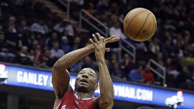 Los Angeles Clippers' Willie Green (34) loses control of the ball as Cleveland Cavaliers' Tristan Thompson (13), from Canada, watches during the third quarter of an NBA basketball game on Saturday, Dec. 7, 2013, in Cleveland. The Cavaliers won 88-82