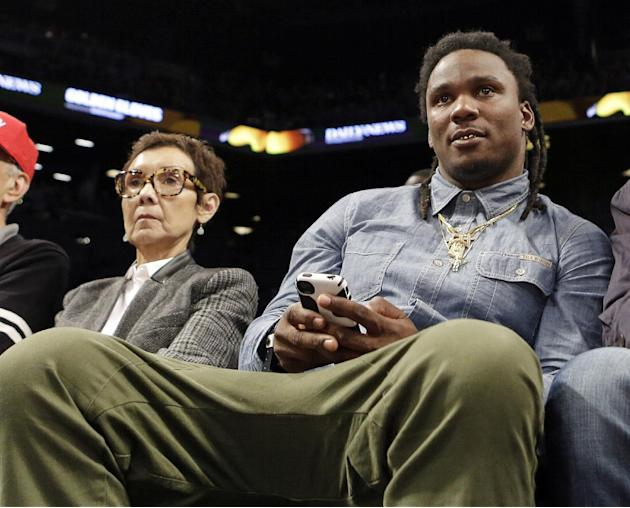 Former Tennessee Titans running back Chris Johnson watches the second half of an NBA basketball game between the New York Knicks and the Brooklyn Nets Tuesday, April 15, 2014, in New York. The The Kni