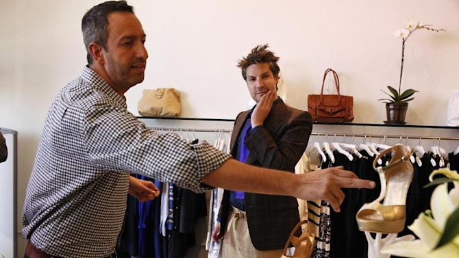 "In this undated photo provided by Bravo, Christos Garkinos, left, and Cameron Silver, owners of Los Angeles vintage store Decades, and hosts of the new reality TV show ""Dukes of Melrose,"" talk about a pair of shoes in their store during one of the show's episodes. Silver and Garkinos hold many style secrets of fashion's royalty, and the duo dish some of them on the new Bravo series. (AP Photo/Bravo, Vivian Zink)"