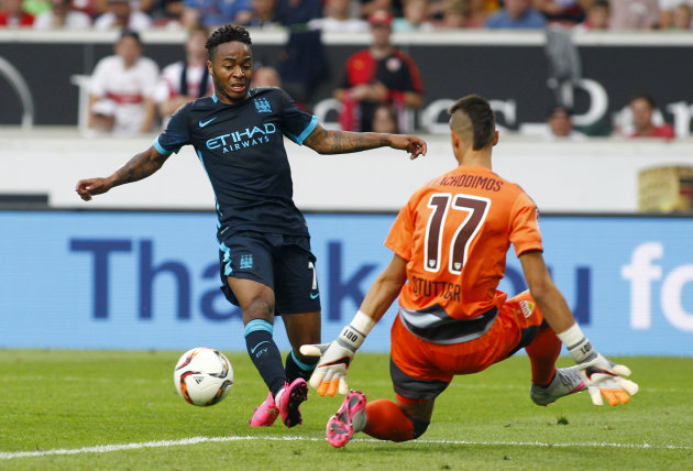 Football - VfB Stuttgart v Manchester City - Pre Season Friendly - The Mercedes-Benz Arena, Stuttgart, Germany - 1/8/15 Manchester City's Raheem Sterling passes the ball to Edin Dzeko before he scores their second goal Action Images via Reuters / John Marsh Livepic EDITORIAL USE ONLY.