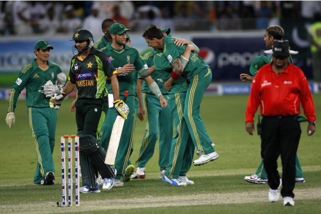 The South African team celebrate the wicket of Pakistan's Shahid Afridi during their second Twenty20 international cricket match in Dubai
