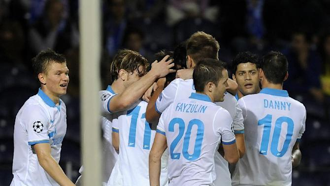 Zenit's Aleksandr Kerzhakov, third left, celebrates with teammates after scoring against Porto during the Champions League group G soccer match between FC Porto and Zenit Tuesday, Oct. 22, 2013, at the Dragao stadium in Porto, northern Portugal. Kerzhakov scored the only goal in Zenit's 1-0 victory