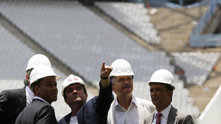 Andres Sanchez, former president of Brazilian soccer club Corinthians, talks with former Brazilian soccer players Cafu, Bebeto and Brazil's Sports Minister Rebelo at the site of the Arena Corinthians stadium in Sao Paulo