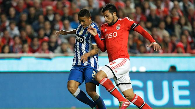 Porto's Danilo, left, fights for the ball with Benfica's Ezequiel Garay, from Argentina, during their Portuguese league soccer match Sunday, Jan. 12 2014, at Benfica's Luz stadium in Lisbon