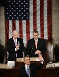 US President Barack Obama waves before delivering his annual State of the Union address to a joint session of Congress at the US Capitol on February 12, 2013, in Washington as Vice President Joe Biden (L) and House Speaker John Boehner (R) look on