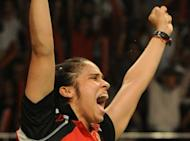 Saina Nehwal of India jubilates after defeating China's Li Xuerui in the women single badminton final at the Indonesian Open Superseries in Jakarta. Nehwal defeated Li to win the Indonesia Open Super Series in Jakarta, sending out a strong message to rivals ahead of the London Olympics next month