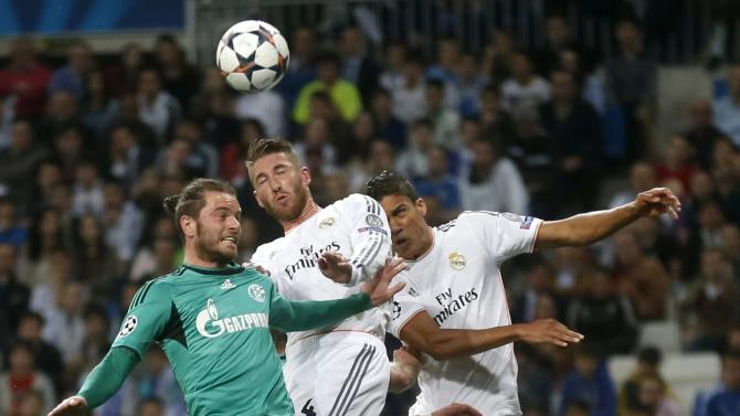 Real Madrid's Ramos and Varane challenges Schalke 04's Hoogland during their Champions League last 16 second leg soccer match at Santiago Bernabeu stadium in Madrid