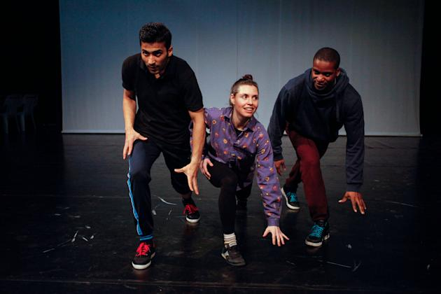 In this Saturday, April 18, 2015 photo, Adil Faraj, left, and his two dance mentors Sean Scantlebury, right, and  Mira Cook rehearse at the National Centre for Culture and Arts in Amman, Jordan, after