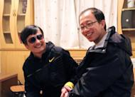"Outspoken government critic Hu Jia (right) with Chen Guangcheng at an undisclosed location in Beijing after the blind lawyer's escape. Hu has been detained in the latest in a string of moves by Chinese security forces against people linked to activist Chen, reportedly under US ""protection"""