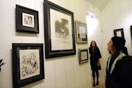 "People check out the art exhibition ""Sendak In Soho"" at Animazing Gallery in 2009 in New York City. Sendak started his career as a freelance book illustrator, creating the illustrations for nearly 50 children's books including the acclaimed ""Little Bear"" series"