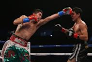 Leo Santa Cruz (L) throws a left hand at Alberto Guevara during their IBF Bantamweight title fight on December 15, 2012 in Los Angeles, California. Santa Cruz won a unanimous 12-round decision over Alberto Guevara in a showdown of Mexican unbeatens on Saturday to retain the International Boxing Federation bantamweight world title