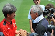 Former Japan international Kazuyoshi Miura with former Italian international Roberto Baggio (R) in Tokyo on June 9, 2013. Miura bettered his own record as the oldest goal scorer ever in the J-League after hammering home a shot just 16 seconds into a game