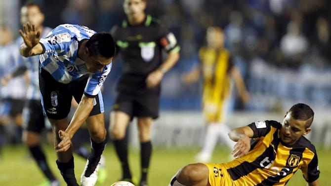 Camacho of Argentina's Racing Club and De la Cruz of Paraguay's Guarani fight for the ball during their Copa Libertadores quarter-final second leg soccer match in Buenos Aires