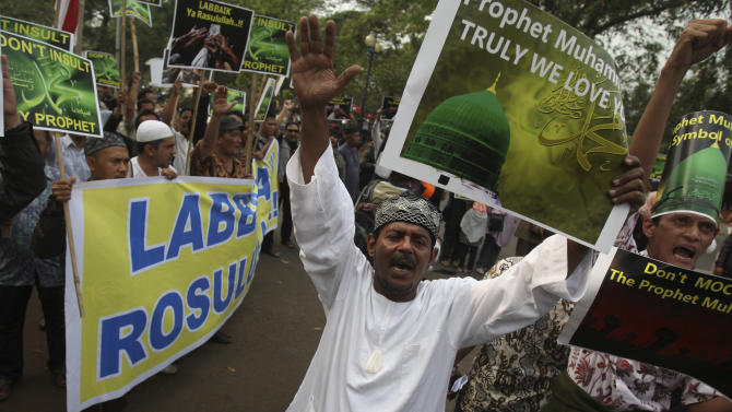 "Indonesian Muslims shout slogans during a protest against an anti-Islam film that has sparked anger among followers, outside the U.S. Embassy in Jakarta, Indonesia, Friday, Sept. 21, 2012. The U.S. has closed its diplomatic missions across Indonesia due to continuing demonstrations over the American-produced film ""Innocence of Muslims,"" which denigrates the Prophet Muhammad. (AP Photo/Achmad Ibrahim)"