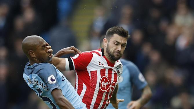 Southampton's Charlie Austin in action with Manchester City's Fernandinho