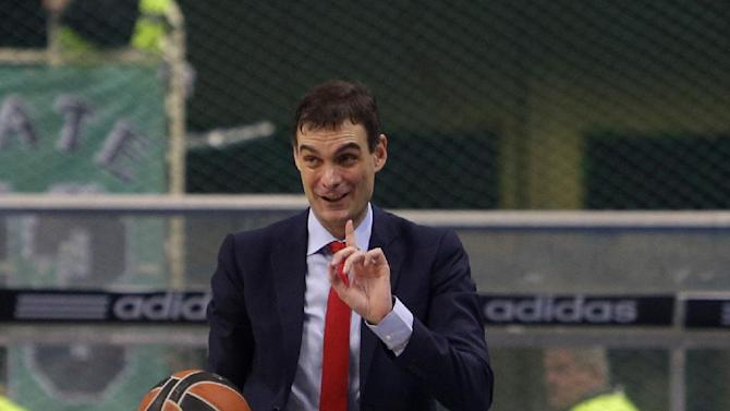 Olympiakos' coach Giorgos Bartzokas reacts after a referee's decision during a Euroleague basketball match of Top 16 against Panathinaikos at the Olympic Indoor Arena in Athens, Thursday, Feb. 20, 2014. Panathinaikos won 66-62