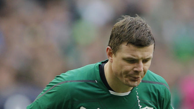 Ireland's Brian O'Driscoll spits out water during the Six Nations Rugby Union match between France and Ireland at the Stade de France stadium, in Saint Denis, outside Paris, Saturday March 15, 2014. (AP Photo/Christophe Ena)