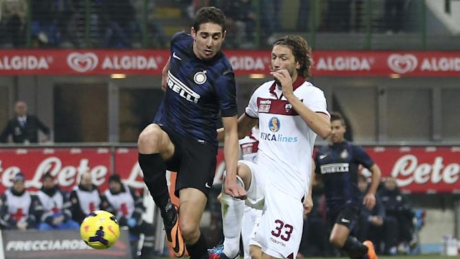 Inter Milan forward Ishak Belfodil, left, of Algeria, scores a goal during the Italian Cup soccer match between Inter Milan and Trapani at the San Siro stadium in Milan, Italy, Wednesday, Dec. 4, 2013