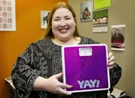 "US-born academic Cat Pause holds her scale during New Zealand's first fat conference at Massey University in Wellington on July 12. Pause proudly describes herself as ""fat"", can live with euphemisms like ""curvy"", ""chunky"" or ""chubby"", but baulks at what she believes are value-laden labels such as ""overweight"" or ""obese"""