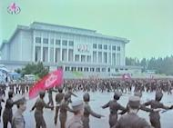 This screen grab taken from North Korean TV North Korean soldiers dance in a plaza after an announcement of North Korean leader Kim Jong-Un's new title of Marshal in Pyongyang