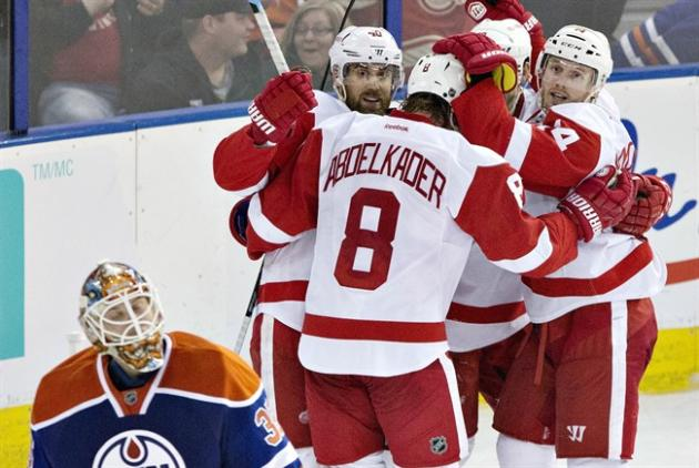 Detroit Red Wings Henrik Zetterberg (40), Justin Abdelkader (8), Pavel Datsyuk (13), and Gustav Nyquist (14) celebrate the game winning goal against the Edmonton Oilers as goalie Viktor Fasth (35) looks on during third period NHL hockey action in Edmonton, Alta., on Tuesday January 6, 2015. THE CANADIAN PRESS/Jason Franson