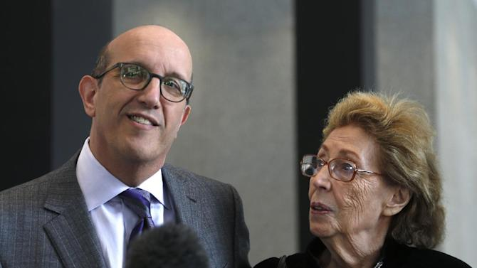 Attorney Shelly B. Kulwin, left, makes a statement with his client Jacqueline Goldberg, after a federal jury returned with a finding in Donald Trump's favor in her civil case alleging that the real estate mogul cheated her in a skyscraper condo deal, Thursday, May 23, 2013 in Chicago. (AP Photo/Charles Rex Arbogast)