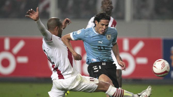 Peru's Rodriguez challenges Uruguay's Cavani for the ball during their 2014 World Cup qualifying soccer match in Lima