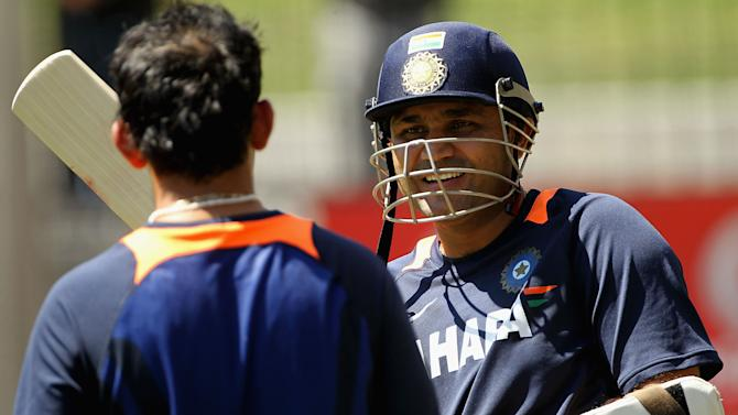MELBOURNE, AUSTRALIA - DECEMBER 23:  Virender Sehwag (R) speaks with team mate Gautam Gambhir during an Indian Test team nets session at Melbourne Cricket Ground on December 23, 2011 in Melbourne, Australia.  (Photo by Hamish Blair/Getty Images)